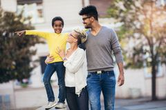 Happy young mixed race couple spending time with their daughter. Having fun royalty free stock image