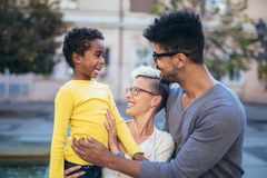 Young mixed race couple spending time with their daughter. Happy young mixed race couple spending time with their daughter royalty free stock images