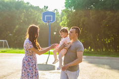 Happy Young Mixed Race Ethnic Family Walking Outdoors Stock Images