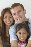 Happy young modern family. Young interracial family with child Stock Image