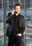 Happy young modern man talking on mobile phone Stock Image
