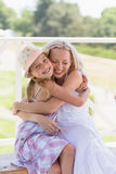 Happy young mom hugging her little daughter. Stock Image