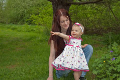 Happy Young Mom and Toddler Daughter Stock Images