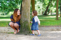 Happy young mother and adorable toddler girl walking through sum Royalty Free Stock Photography