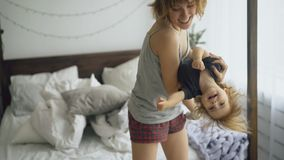 Free Happy Young Mother And Little Cute Daughter Dancing Near Bed In Bedroom At Home Royalty Free Stock Photography - 105294877