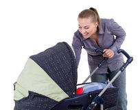 Happy young mother with baby  buggy Stock Photography