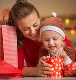 Happy young mother and baby checking christmas purchases Stock Image