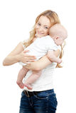 Happy young mother and baby in her hands Stock Images