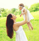 Happy young mother and baby together outdoors in sunny summer Royalty Free Stock Image
