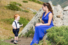Happy young mother with child boy on nature. The concept cheerful childhood family royalty free stock photography