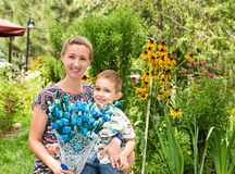 Happy young mother with child boy on nature Royalty Free Stock Photography