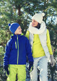 Happy young mother and child dressed in bright sportswear have fun together against christmas tree Royalty Free Stock Images