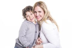 Happy young mother with a child on light background royalty free stock photo