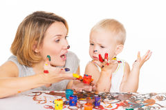 Happy young mother and child with painted hands. Happy young mother and child with painted hands - isolated on white Stock Photography