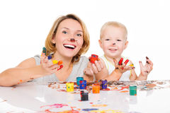 Happy young mother and child with painted hands. Royalty Free Stock Photos