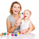 Happy young mother and child with painted hands. Royalty Free Stock Photo