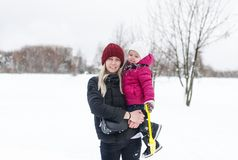 Happy young mother with a child on a winter walk. Horizontal portrait royalty free stock images