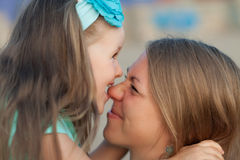 Happy young mother and daughter. Stock Images