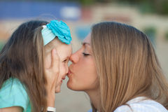 Happy young mother and daughter. Royalty Free Stock Image