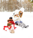 Happy young mother with daughter on winter picnic Royalty Free Stock Images