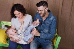 Happy young mother, father play with little son Royalty Free Stock Image