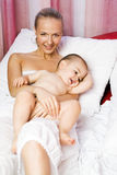 Happy young mother and her baby Stock Photo