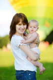 Happy young mother with her baby son stock photo