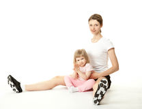Happy young mother and her daughter doing sport Stock Photo