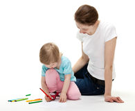 Happy young mother and her daughter drawing Royalty Free Stock Images