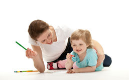 Happy young mother and her daughter drawing Royalty Free Stock Photos