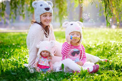 Happy young mother and her daughter playing in summer park Royalty Free Stock Photography