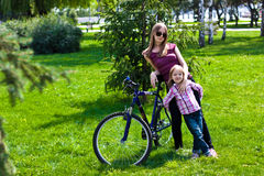 happy young mother with her daughter riding bicyc Stock Image