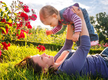 Happy young mother with her little daughter. Happy young mother playing with little daughter in park Royalty Free Stock Photos