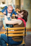 Happy young mother with her little son in a cafe Royalty Free Stock Images