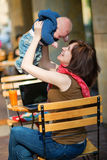 Happy young mother with her little son in a cafe Stock Images