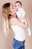 Happy young mother with her little son Stock Images