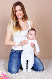 Happy young mother with her little son Stock Photos