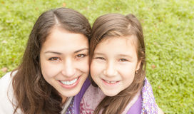 Happy young mother with her small daughter. Royalty Free Stock Photography