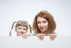 Happy young mother with her smiling daughter Stock Photos
