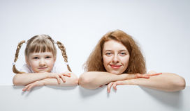 Happy young mother with her smiling daughter Stock Photo