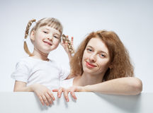 Happy young mother with her smiling daughter Royalty Free Stock Images
