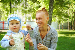 Happy young mother with her son Stock Images