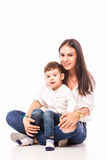 Happy young mother and her son posing together. Stock Photos