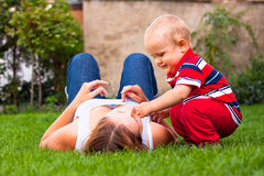 Happy young mother and her son relaxing outdoors Stock Photo