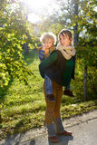 Happy young mother and her son spending time in the autumn park Stock Image
