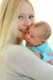 Happy Young Mother Holding Cuddly Newborn Baby Stock Images
