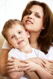 Happy young mother hugging her little son Royalty Free Stock Image