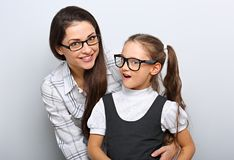Happy young mother and laughing kid in fashion glasses hugging royalty free stock image