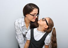 Happy young mother and laughing kid in fashion royalty free stock images