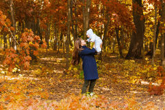 Happy young mother with little daughter in autumn Royalty Free Stock Photography